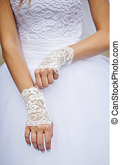bride in white dress with gloves