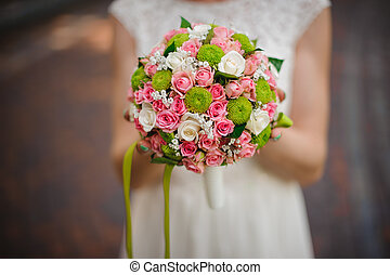 Bride in white dress with wedding bouquet. no face - Bride...