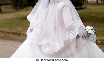 Bride in white wedding dress swirls