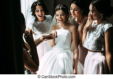 Bride is showing her engagement ring