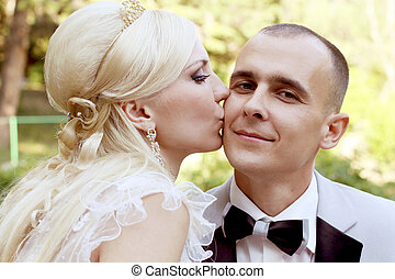 Bride kissing groom with love
