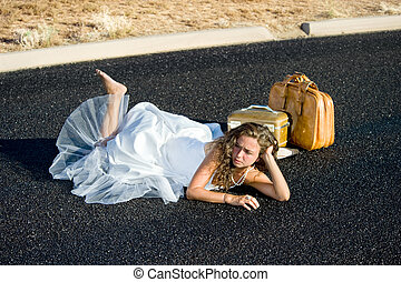 Bride laying in street - A bride is kicked to the curb and...