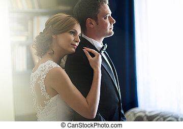 Bride leaning on grooms shoulder