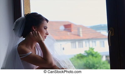 Bride Leans Back in the Window