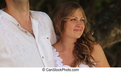bride listen to groom embracing him