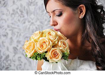BRIDE LOOKING AT BOUQUET