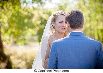 Bride looking at groom gently