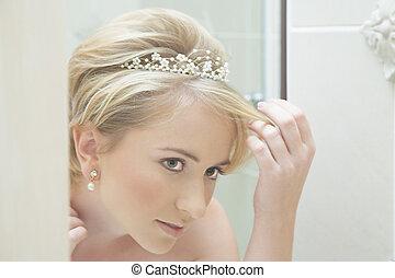 Bride looking in a mirror - Reflection of a young bride ...