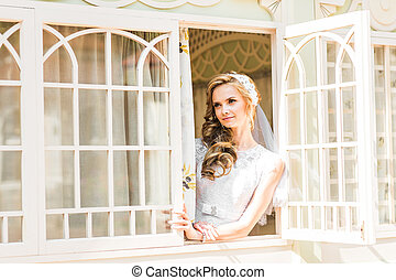bride looking through the window