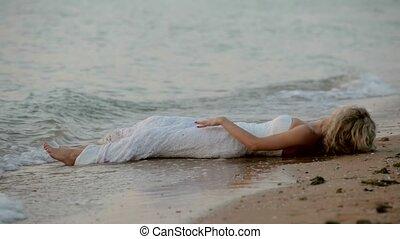Bride Lying On The Beach