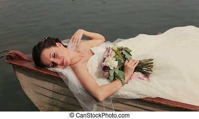 bride lying on the  boat