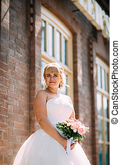 Bride on a background of city street