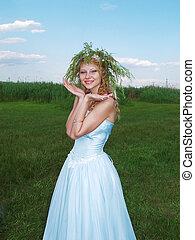 Bride on a green meadow