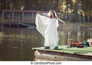 Bride on a wakeboard on the lake.