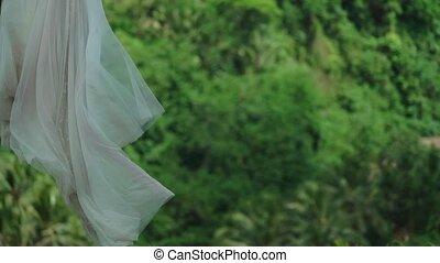 Bride on swings in tropical Bali
