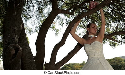 Bride on the nature - A beautiful young girl in a wedding...