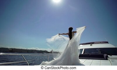 Bride on yacht - Bride waving dress on yacht