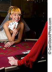 Bride plays casino - young woman in a wedding dress in...