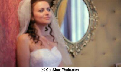 Bride Posing In A Room With A Mirror