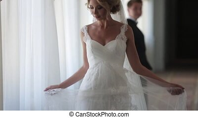 Bride posing in hotel indoors