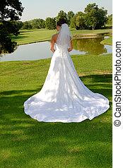 Bride posing outdoors.