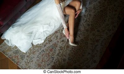 Bride put on shoes - Bride put on her shoes