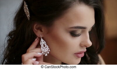 Bride puts on earring - Beautiful bride puts on earring...