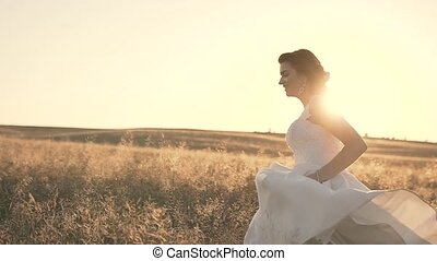 Bride Runs in the Field at Sunset
