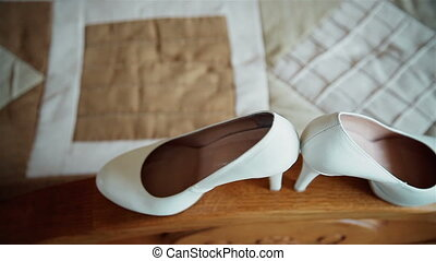 Bride shoes on a wooden railing