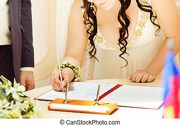 Bride signing the wedding contract