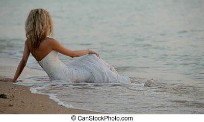 Bride Sits On The Beach