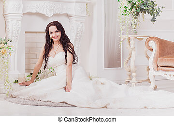 Bride sitting near fireplace