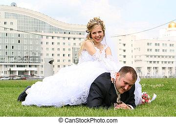 Bride sitting on the groom