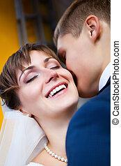 Bride smiling while groom telling her something - Beautiful...