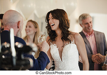 Bride Socialising On Her Wedding Day