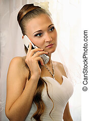 bride speaks on the phone
