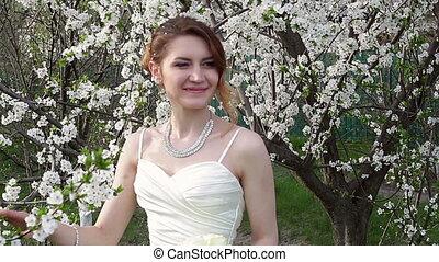 Bride standing in flowers - Bride standing in a beautiful...