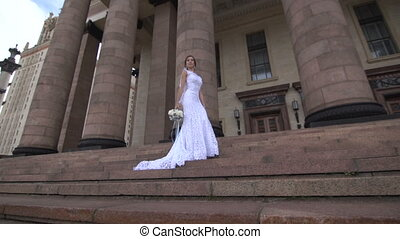 Bride standing on the steps near the columns