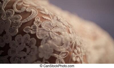 bride stands back to camera, groom strokes on shoulder on...
