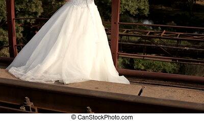 Bride stands on the bridge