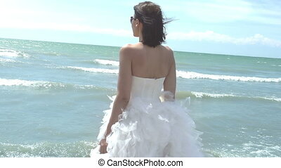 Bride - The girl in an elegant wedding dress standing on the...