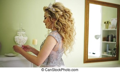 Bride takes a cup of coffee from the mantelpiece and takes a...