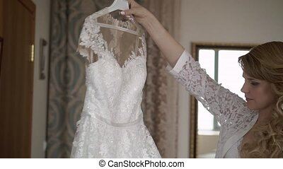 Bride takes wedding dress