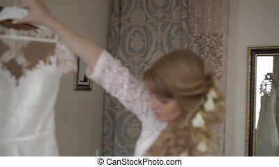 Bride takes wedding dress - Blonde bride takes wedding dress
