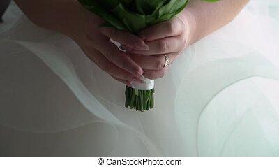 Bride taking flowers bouquet
