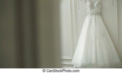 Bride taking her wedding dress