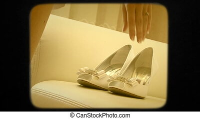 Bride Taking Wedding Shoes Off The Sofa - Two frames: left...