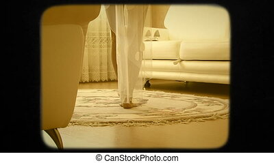 Bride Taking Wedding Shoes Off The Sofa. Retro Style