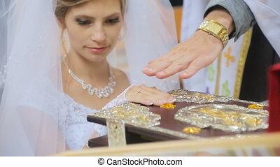 Bride taking wedding vows in church