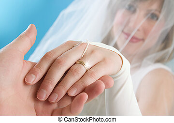 Bride - The bride stretches a hand with a ring